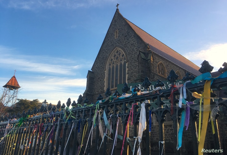 Colorful ribbons can be seen tied to the fence outside St. Patrick's Cathedral, a spontaneous gesture to remember victims of Roman Catholic church abuse, in the town of Ballarat, located west of the southern city of Melbourne in Australia, July 23, 2...