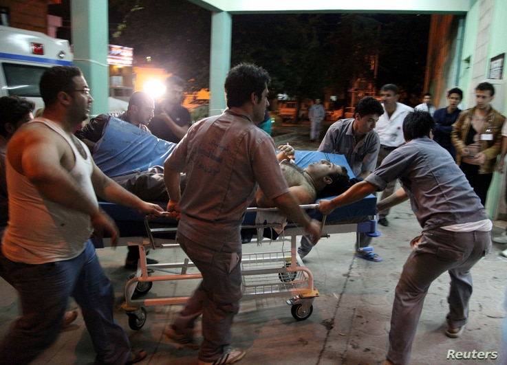 A victim of a bomb attack, which occurred in Khanaqin, is wheeled on a gurney into a hospital in Sulaimaniya April 28, 2014. A suicide attacker killed at least 30 people and wounded 50 others at a Kurdish political gathering in the town of Khanaqin, ...