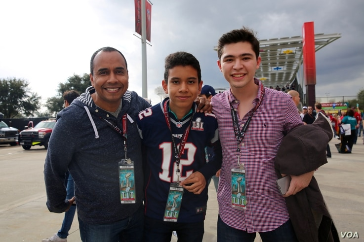 """Fans proudly display their tickets to the Super Bowl -- where the cheapest """"get-in"""" ticket will go for around $2,000. (B. Allen/VOA)"""
