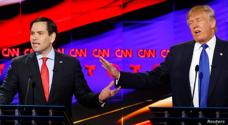 Republican U.S. presidential candidates Marco Rubio (L) and Donald Trump speak simultaneously at the debate sponsored by CNN for the 2016 Republican U.S. presidential candidates in Houston, Texas, Feb. 25, 2016.