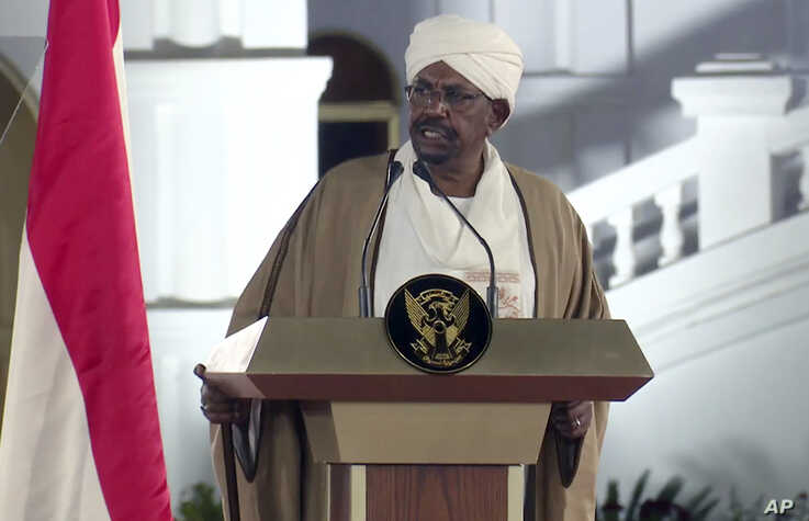 Sudan's President Omar al-Bashir speaks at the Presidential Palace, Feb. 22, 2019, in Khartoum, Sudan. He declared a state of emergency for a year and disbanded the government amid deadly protests.