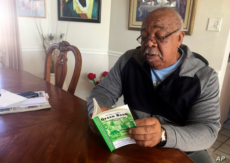"Charles Becknell, Sr., 77, holds a copy of 1954 the edition of ""The Negro Motorist Green Book"" at his home in Rio Rancho, N.M., Jan. 31, 2019."