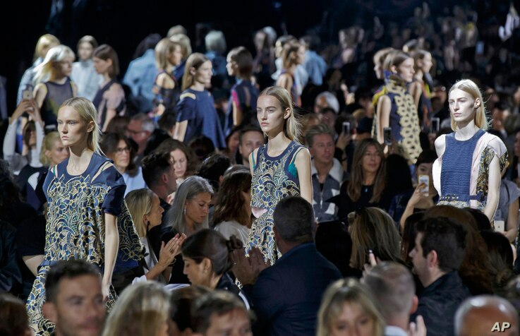 Models wear creations for Sacai's Spring-Summer 2016 ready-to-wear fashion collection presented in Paris, France, Oct. 5, 2015.