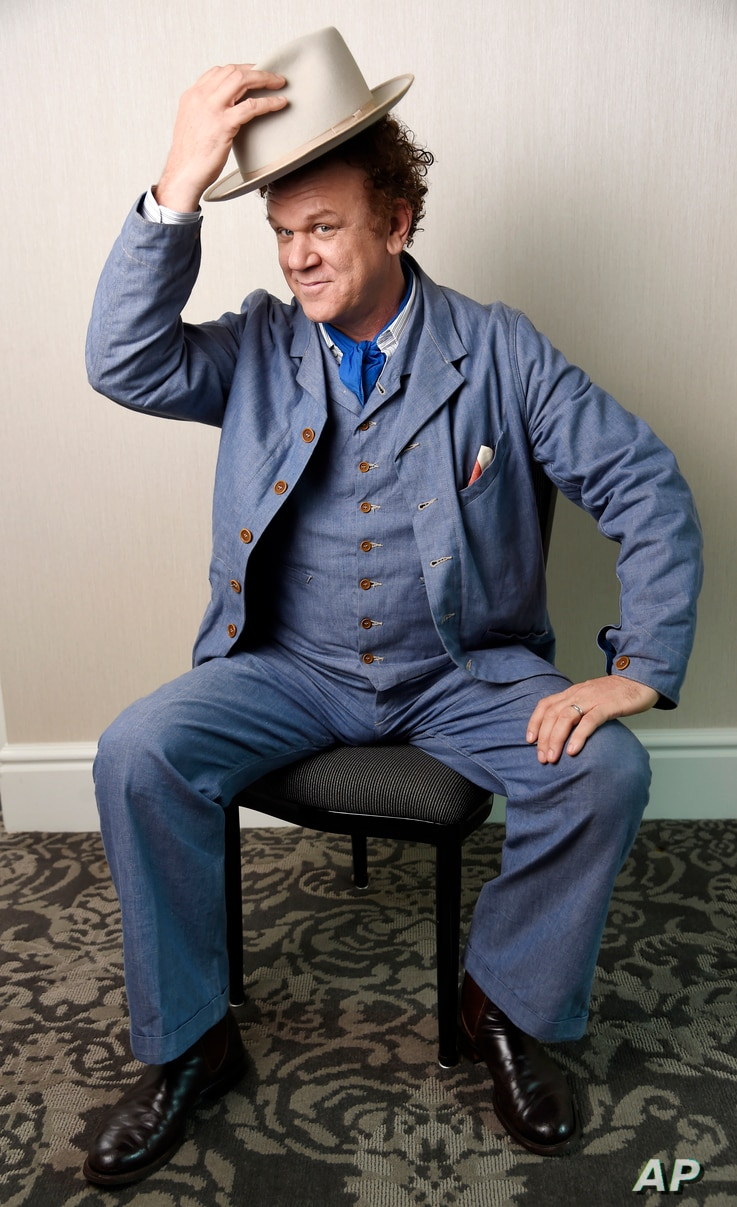 """In this Sept. 8, 2018 photo John C. Reilly, a cast member in the film """"The Sisters Brothers,"""" poses for a portrait at the Adelaide Hotel during the Toronto International Film Festival in Toronto."""