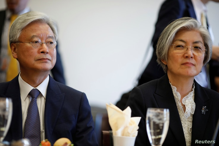 South Korean Foreign Minister Kang Kyung-wha (R), sits with South Korean Ambassador to the United States Ahn Ho-young prior to a meeting with the House Committee on Foreign Affairs in Washington, U.S., March 15, 2018.