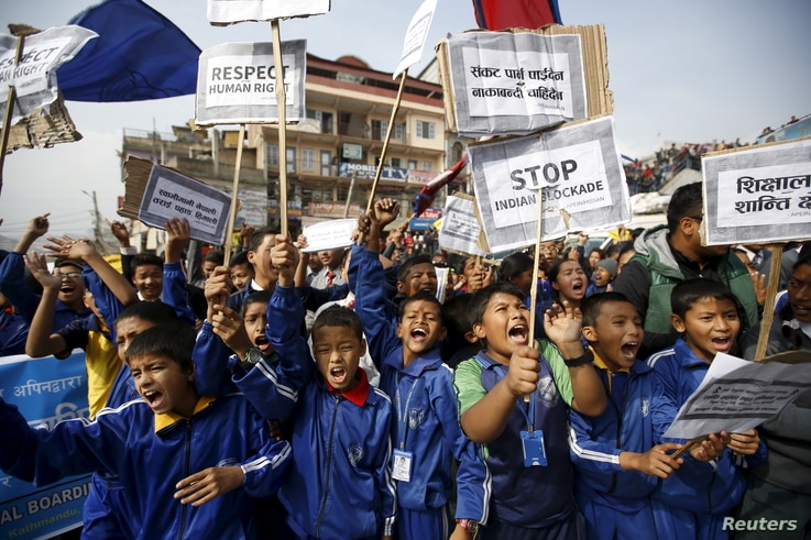 FILE - Nepalese students holding placards take part in a protest to show solidarity against the border blockade in Kathmandu, Nepal, Nov.  27, 2015.