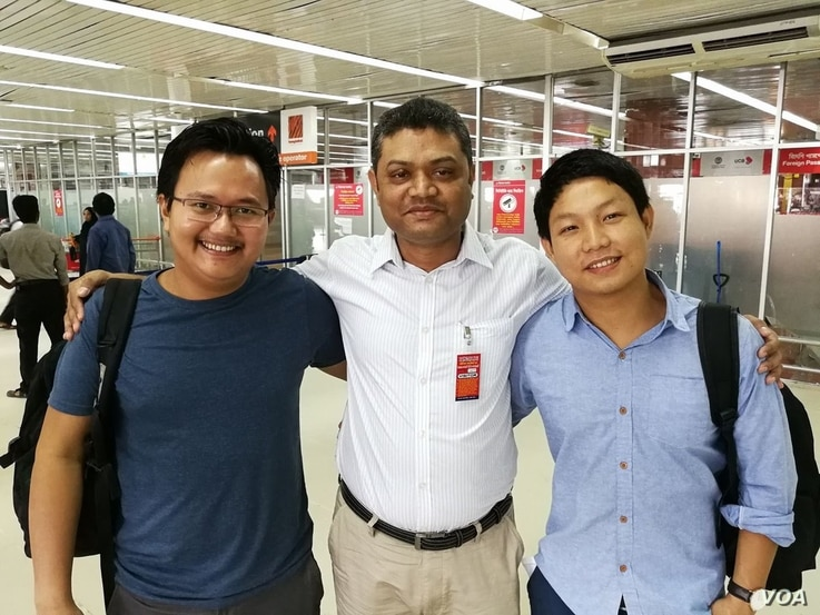 Myanmar photojournalists Minzayar Oo and Hkun Lat are seen with their lawyer in a photo posted on Twitter, Oct. 17, 2017.