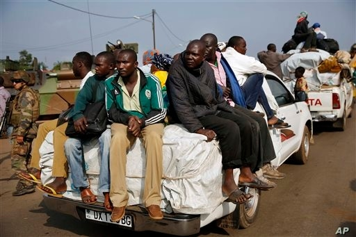 At PK12, the last checkpoint at the exit of the town, thousands of Muslim residents from Bangui and Mbaiki flee the Central African Republic capital Bangui in a mass exodus using cars, pickups, trucks, lorries and motorcycles, escorted by Chadian tro...
