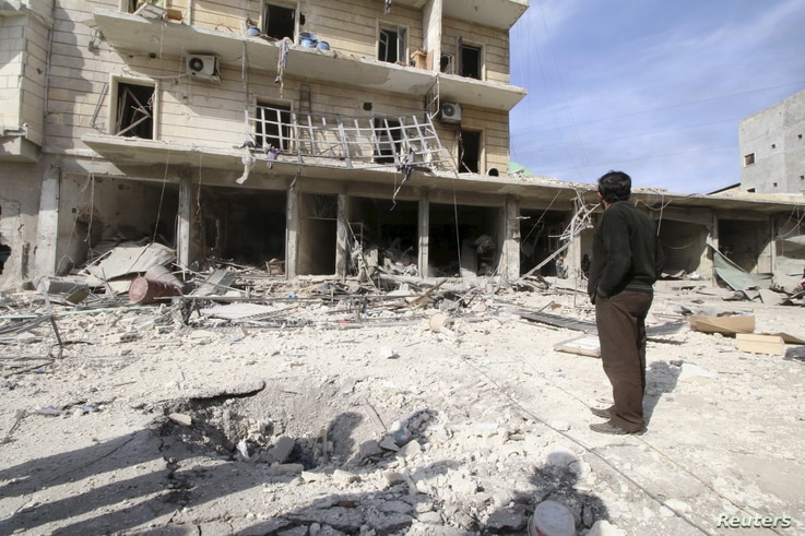 People inspect the damage after airstrikes by pro-Syrian government forces in the rebel held al-Sakhour neighbourhood of Aleppo, Syria, Feb. 5, 2016.