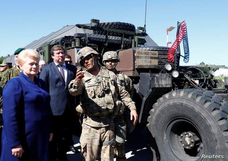 Lithuania's President Dalia Grybauskaite listens to U.S. soldiers next to a Patriot missle system during Toburq Legacy 2017, an air defense exercise, in a military airfield near Siauliai, Lithuania, July 20, 2017.