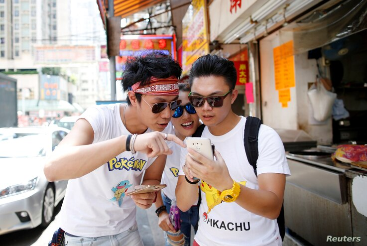 "From left, Cheng Lai, 30, Jennifer Wu, 26, and Adam Lo, 28, take part in the world's first ""Pokemon Go competition in Hong Kong, China, Aug. 6, 2016."