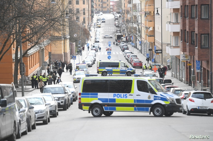 Police vans block the street outside the Stockholm District Court as Uzbek national Rakhmat Akilov, prime suspect in a truck attack that killed 4 people, appears in court, in Stockholm, Sweden, April 11, 2017.