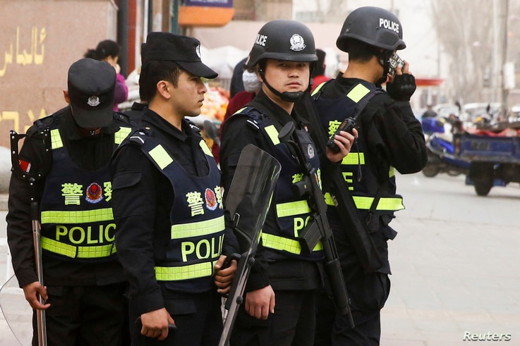 Armed police keep watch in a street in Kashgar, Xinjiang Uighur Autonomous Region, China, March 24, 2017.