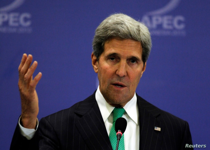 U.S. Secretary of State John Kerry gestures during a news conference at the Asia Pacific Economic Cooperation (APEC) ministerial meeting in Nusa Dua, Bali island Oct. 5, 2013.