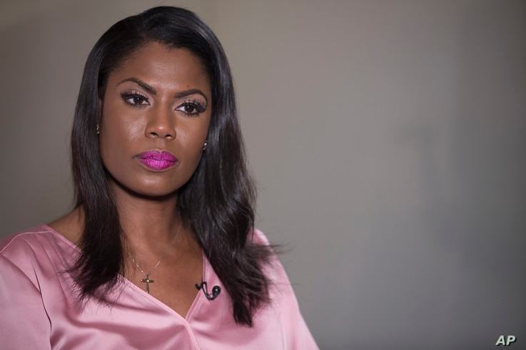 Former White House staffer Omarosa Manigault Newman listens during an interview with The Associated Press,  Aug. 14, 2018, in New York.
