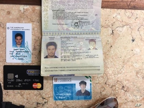In this photo released by the Egyptian Ministry of Interior on Thursday, Mar. 24, 2016, personal belongings of slain Italian graduate student Giulio Regeni, including his passport, are displayed.