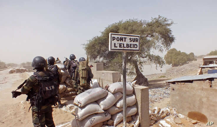 FILE - Cameroonian soldiers stand guard at a lookout post as they take part in operations against Boko Haram militants on Elbeid bridge that separates northern Cameroon form Nigeria's Borno state near the village of Fotokol, Cameroon, Feb. 25, 2015.