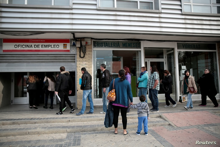 FILE - People enter a government-run job centre in Madrid, Spain, April 27, 2016.