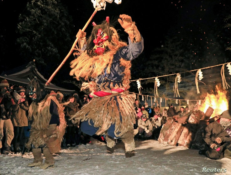 Men dressed as a deity called Namahage perform a dance during the Namahage Sedo Festival at Shinzan Shrine in Oga, Akita Prefecture, Japan, in this photo taken by Kyodo, Feb. 8, 2019.