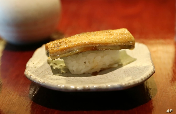 FILE - A dish of eel nigiri is served at Miyake, a Japanese restaurant, in Portland, Maine, July 20, 2017.