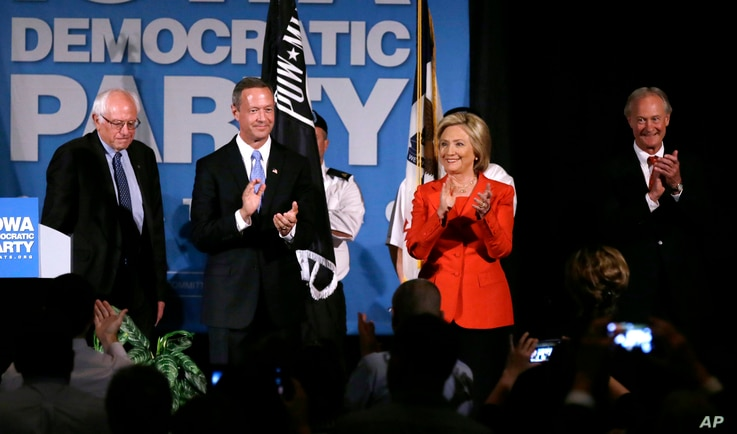 FILE - Democratic presidential candidates, from left, Bernie Sanders, Martin O'Malley, Hillary Clinton and Lincoln Chafee stand on stage during the Iowa Democratic Party's Hall of Fame Dinner in Cedar Rapids, Iowa, July 17, 2015.