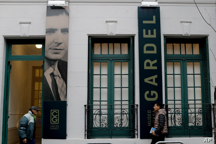 People walk in front of the Carlos Gardel museum in Buenos Aires, Argentina, July 5, 2017.