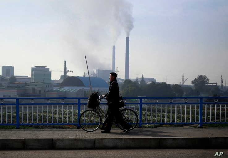 FILE - Smoke billows from the chimneys of Pyongyang Power Plant, which supplies much of the power and hot water needs for central Pyongyang, in Pyongyang, North Korea, Oct. 21, 2018. U.S. President Donald Trump said he walked away from his second sum...