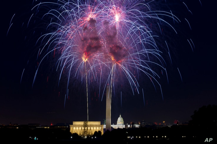 Fireworks explode over Lincoln Memorial, Washington Monument and U.S. Capitol along the National Mall in Washington, July 4, 2018, during the Fourth of July celebration.