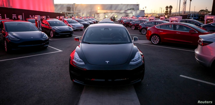 Tesla Model 3 cars are seen at an event at the factory handing over its first 30 Model 3 vehicles to employee buyers at the company's Fremont facility in California, July 28, 2017.