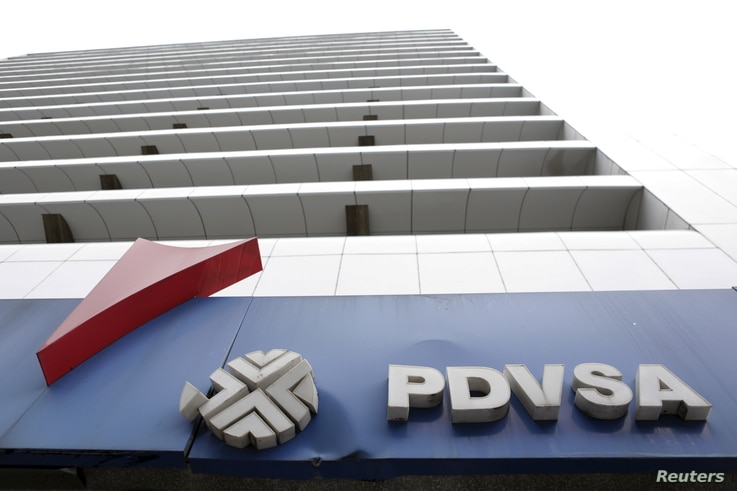 The PDVSA logo for Venezuela's state-owned oil company is seen at a gas station in Caracas, Dec. 21, 2015.