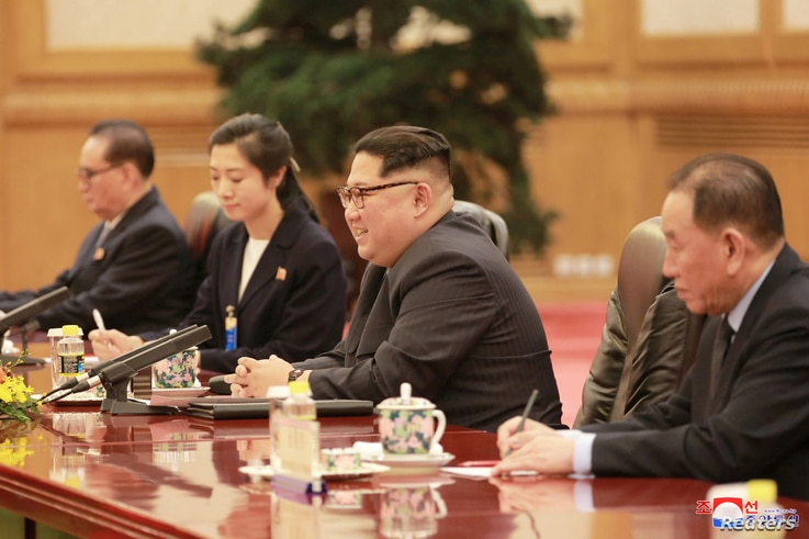 North Korean leader Kim Jong Un smiles during a meeting with Chinese President Xi Jinping (unseen) in Beijing, as he visits China, in this undated photo released by North Korea's Korean Central News Agency in Pyongyang, March 28, 2018.