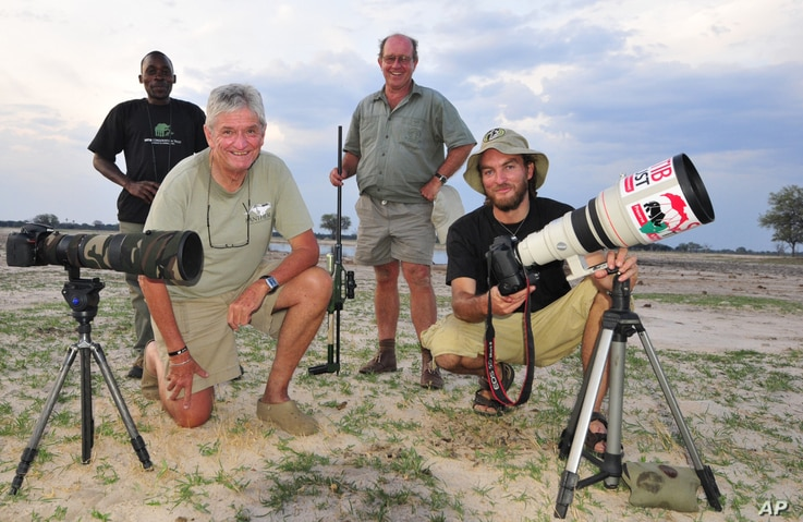 Photographer Brent Stapelkamp is seen with colleagues at the Hwange National Park in this 2014 photo. Stapelkamp, a lion researcher and part of a team that had tracked and studied Cecil the lion for nine years, darted him and attached a collar last y...