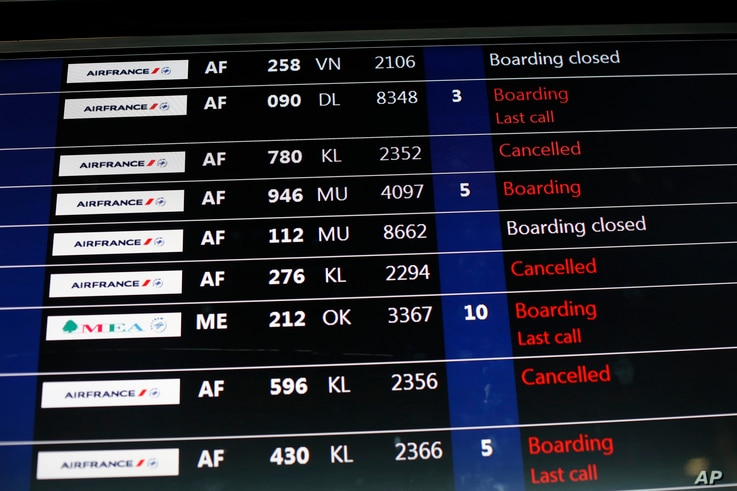 A passenger information board displays some disruptions at Roissy Charles de Gaulle Airport, in Roissy, north of Paris, Thursday, Feb.22, 2018.