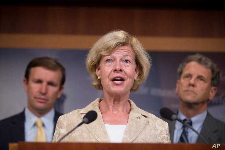FILE - Sen. Tammy Baldwin, D-Wis., pictured at a Washington news conference in July 2015, will address the 2016 Democratic National Convention in Philadelphia. Baldwin is the first openly gay person to serve in the U.S. Senate.