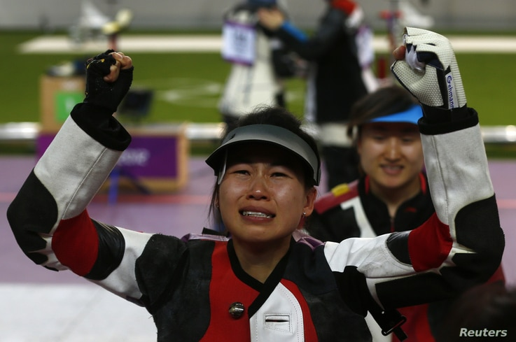 China's Yi Siling reacts after winning the women's 10m air rifle final competition at the London 2012 Olympic Games in the Royal Artillery Barracks at Woolwich in southeast London July 28, 2012.
