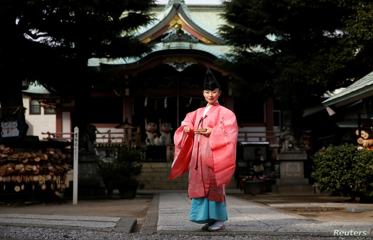 Shinto priest Tomoe Ichino, 40, poses for a photograph at the Imado Shrine in Tokyo, Japan, Feb. 22, 2017.