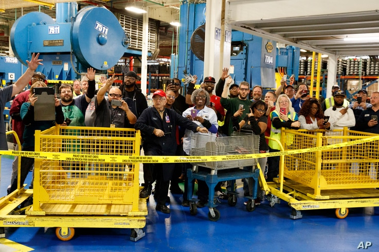 Employees of Carrier watch as President-elect Donald Trump and Vice President-elect Mike Pence take a tour in Indianapolis, Indiana, Dec. 1, 2016.