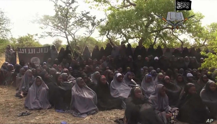 FILE-In this file photo taken from video released by Nigeria's Boko Haram terrorist network, May 12, 2014, shows missing girls abducted from the northeastern town of Chibok.