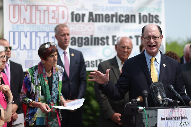 U.S. Rep. Brad Sherman of California and fellow Democratic members of Congress hold a news conference to voice their opposition to the Trans-Pacific Partnership trade deal and fast-track trade authority for the president at the U.S. Capitol in Washin...