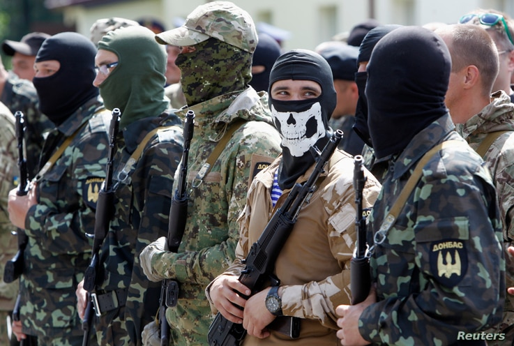 """Members of the """"Donbas Battalion"""" take part in a swearing in ceremony near Kyiv, June 23, 2014."""