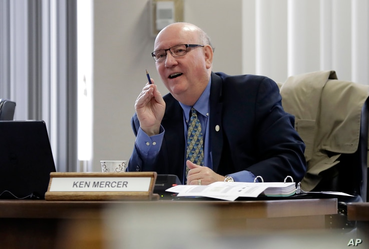 Texas school board member Ken Mercer asks a question as the board listens to public testimony on history curriculum, Nov. 13, 2018, in Austin, Texas.