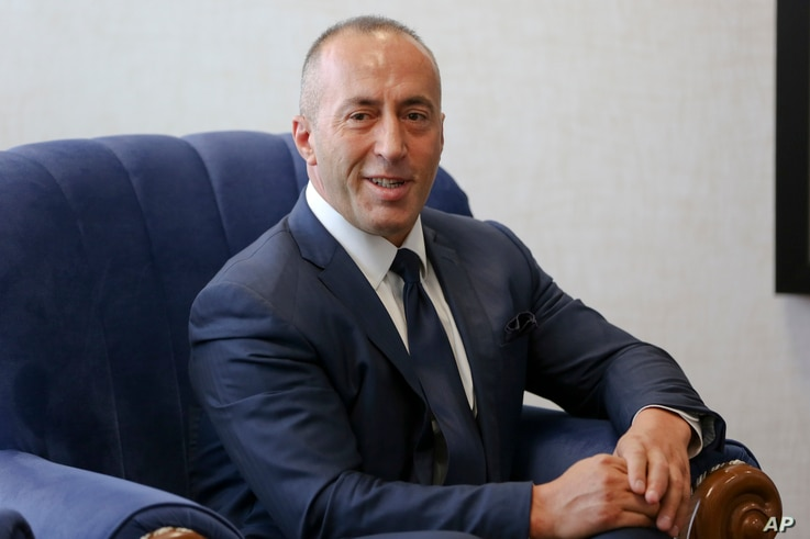 Kosovo's newly elected prime minister Ramush Haradinaj smiles during a welcoming hand over ceremony, Sept. 11, 2017, in Kosovo capital Pristina.