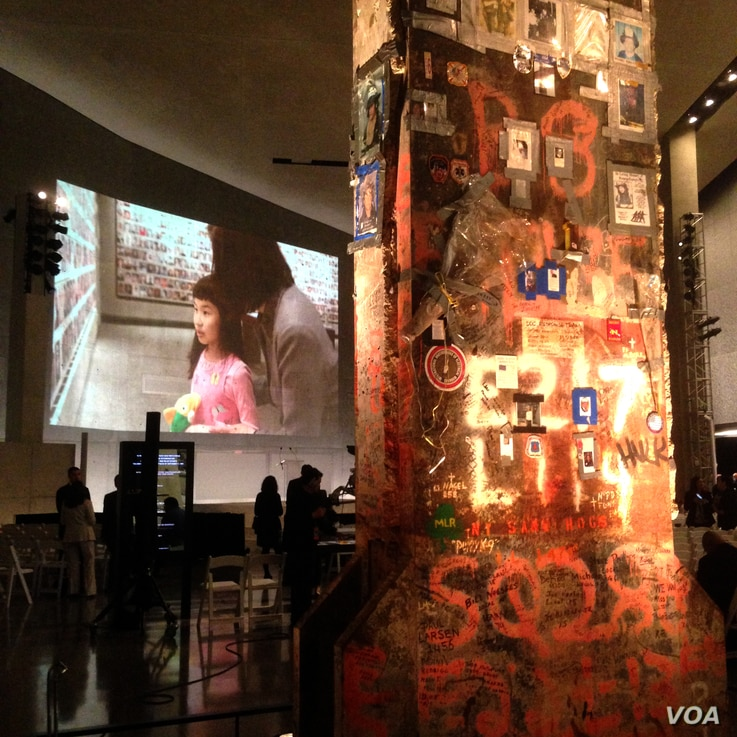 Inside the National September 11 Memorial Museum, the last World Trade Center column to be cut away from Ground Zero is covered in graffiti messages by those who cleared the site after the attack, Ground Zero, New York City, May 15, 2014. (Adam Phill...