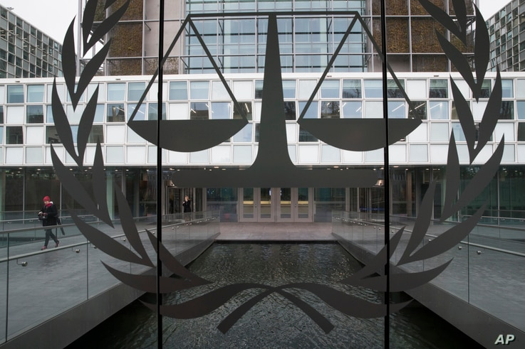 A person leaves the International Criminal Court in The Hague, Netherlands, Jan. 16, 2019.