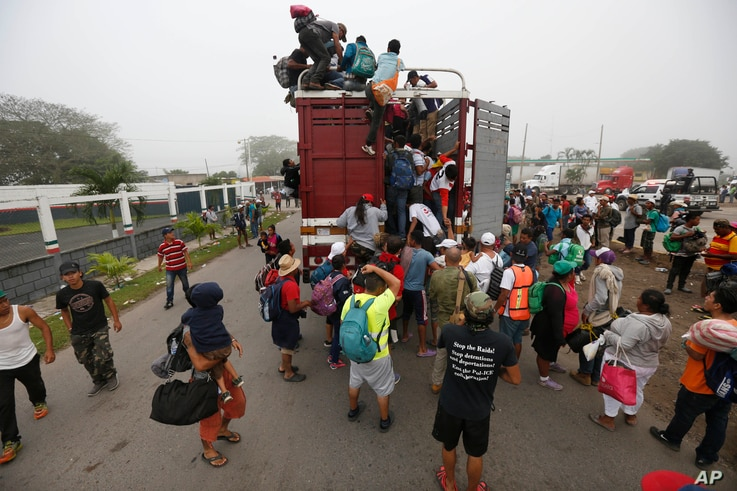 Central American migrants pack into the back of a trailer truck as they begin their morning trek as part of a thousands-strong caravan hoping to reach the U.S. border, in Isla, Veracruz state, Mexico, Sunday, Nov. 4, 2018.
