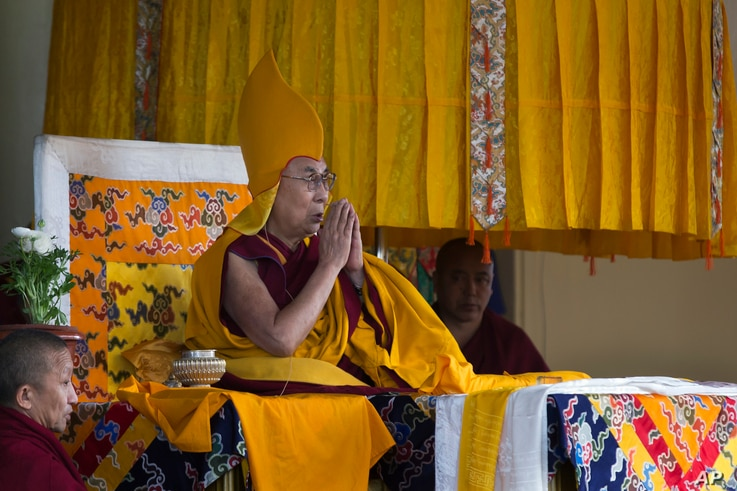 Tibetan spiritual leader the Dalai Lama wears the ceremonial hat of the Gelug school of the Tibetan Buddhism as he prays during his religious talk at the Tsuglakhang temple in Dharmsala, India, March 2, 2018.