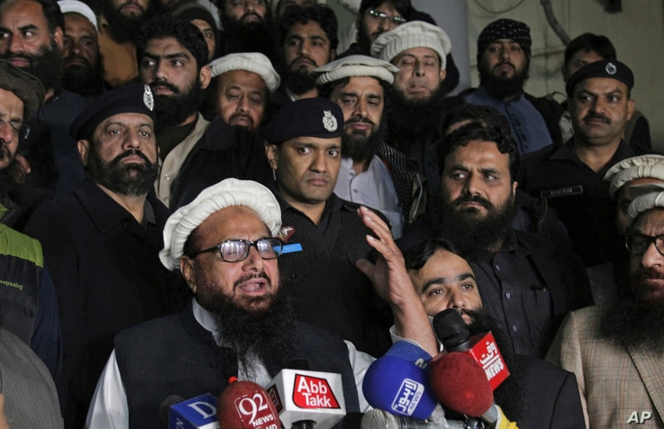 FILE - Hafiz Mohammad Saeed, leader of the Pakistani religious group and charity Jamaat-ud-Dawa, addresses his supporters outside the party's headquarters, in Lahore, Pakistan, Jan. 30, 2017.