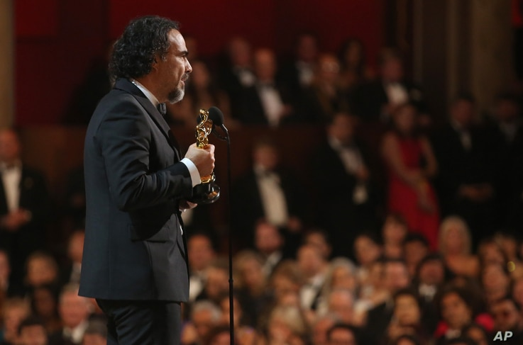 """Alejandro G. Inarritu is seen from backstage as he accepts the award for best director for """"The Revenant"""" at the Oscars, Feb. 28, 2016, at the Dolby Theatre in Los Angeles."""