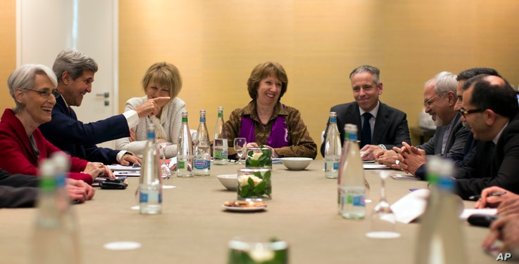 U.S. Secretary of State John Kerry, second left, meets with EU High Representative for Foreign Affairs, Catherine Ashton, center, and Iranian Foreign Minister Mohammad Javad Zarif, third right, at the Iran Nuclear talks in Geneva, Switzerland, Nov. 9