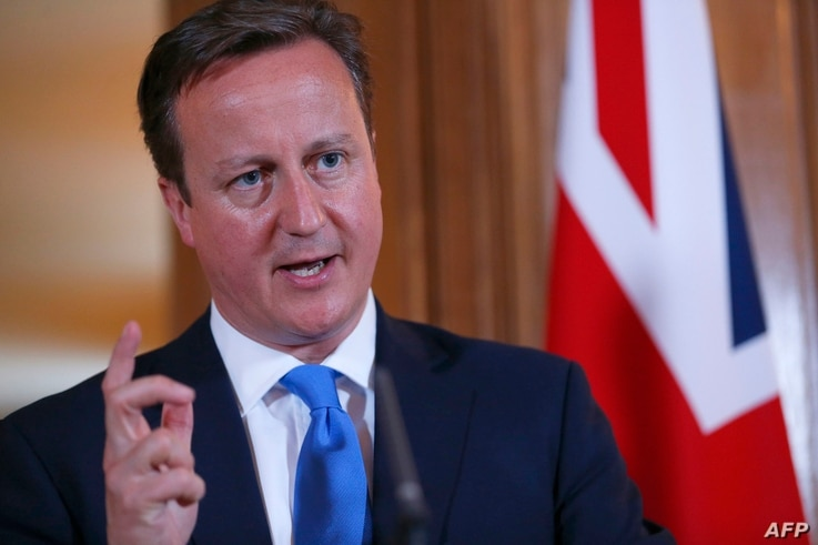 Britain's Prime Minister David Cameron (R) speaks during a joint press conference with his Italian counterpart Enrico Letta (L) following a meeting in London, July 17, 2013.